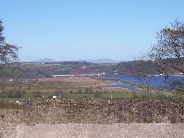 YOUGHAL TOWN WALLS showing a view over the town and across the Blackwater River to County Waterford; Youghal Bridge can be seen in the background. Photo K. Donnelly